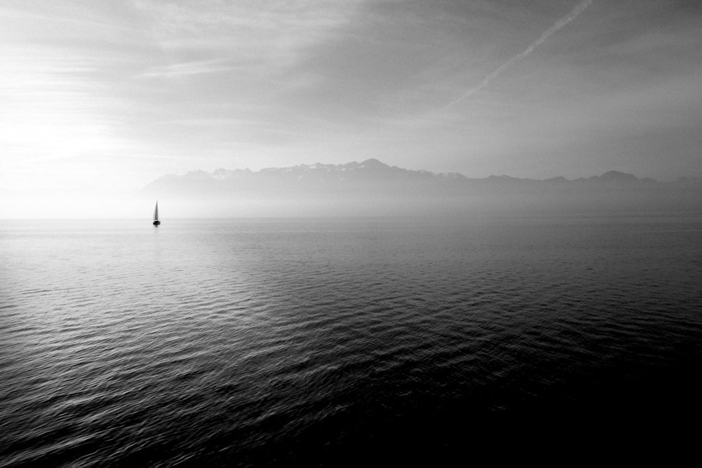 image of sailboat on still waters